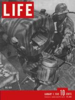 Life Magazine, January 1, 1945 - Soldier cleaning gun