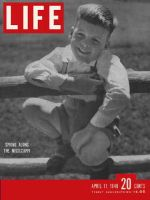 Life Magazine, April 11, 1949 - Young boy on fence