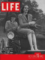 Life Magazine, July 22, 1946 - Woman riding in carriage