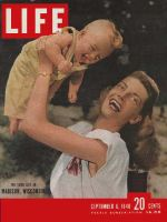 Life Magazine, September 6, 1948 - Woman lifting baby in Madison, Wisconsin