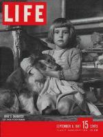 Life Magazine, September 8, 1947 - Little English girl hugging Dog