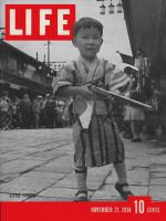Life Magazine, November 21, 1938 - Japanese boy with Gun
