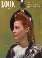 Look Magazine, February 9, 1943 - Lovely red-headed woman in the dress tartan of clan MacPherson with cairngorm brooch on her plaid