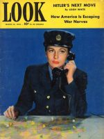 Look Magazine, March 10,1942 - Actress Joan Fontaine at desk in the uniform of Britain's WAAF