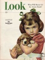 Look Magazine, March 16, 1948 - Cute little girl holding puppy