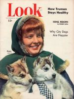 Look Magazine, November 8, 1949 - Girl with two sled dog pups