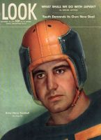 Look Magazine, November 28, 1944 - Football player in orange and black leather helmet