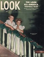 Look Magazine, December 24, 1946 - Two cute kids in candy strip pajamas on a garland-decked staircase
