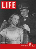 Life Magazine, January 6, 1947 - Man helping woman with coat
