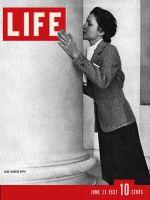 Life Magazine, June 21, 1937 - Woman Kissing Column