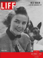 Life Magazine, December 4, 1950 - West Berliners, woman with dog