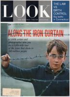 Look Magazine, January 30, 1962 - Boy behind barbed wire fence
