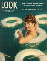 Look Magazine, February 5, 1946 - model Colleen Townsend in water with life preservers