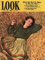 Look Magazine, May 5, 1942 - Pretty lady laying in straw