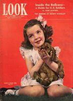 Look Magazine, June 15, 1943 - Charming little girl holding her dog