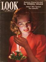 Look Magazine, December 29, 1942 - Lovely candlelit photo of woman holding Christmas candle